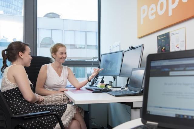 women at desk