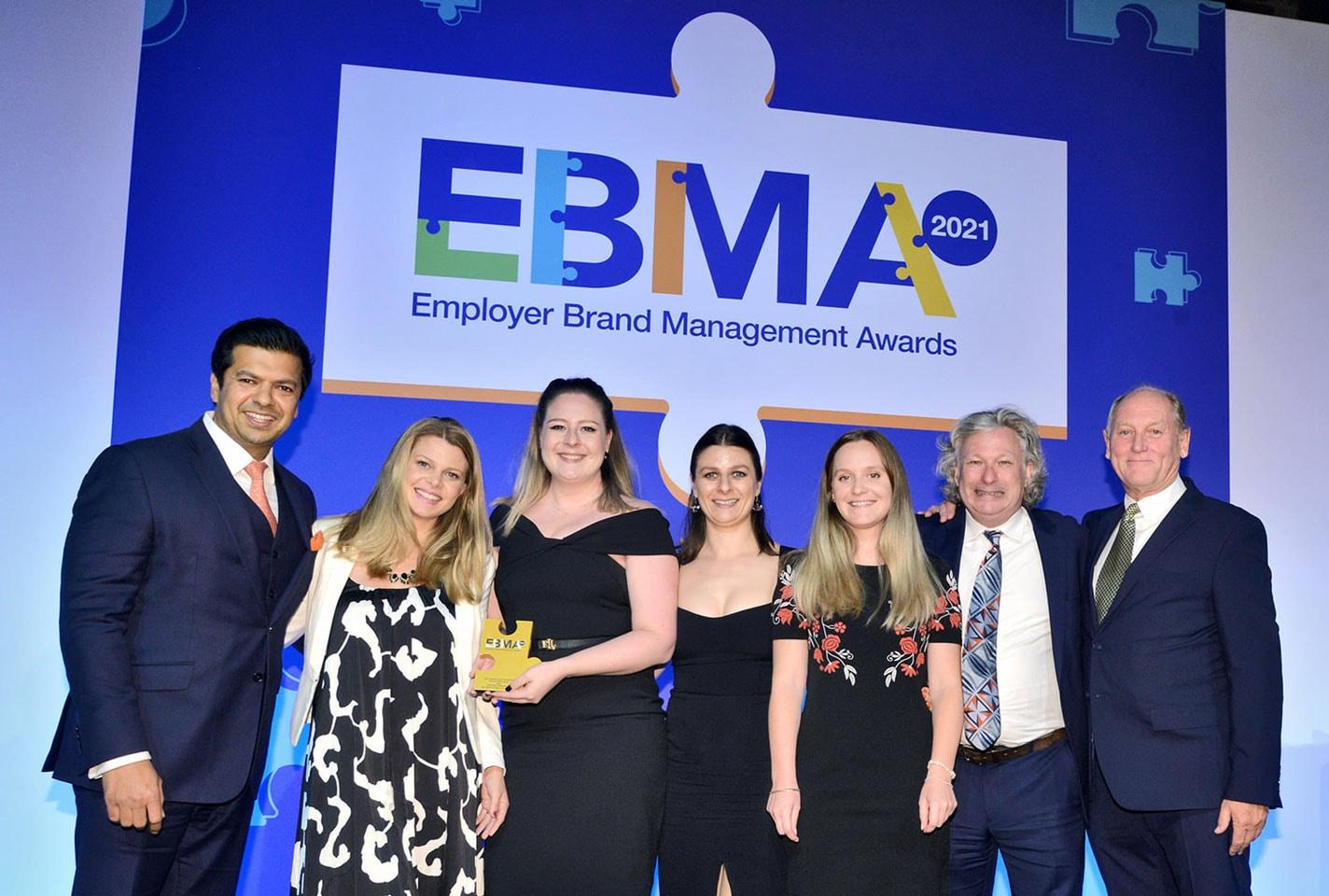 PMI team collecting award at EBMA Awards