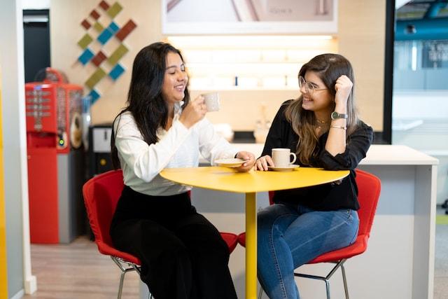 women drinking coffee banner