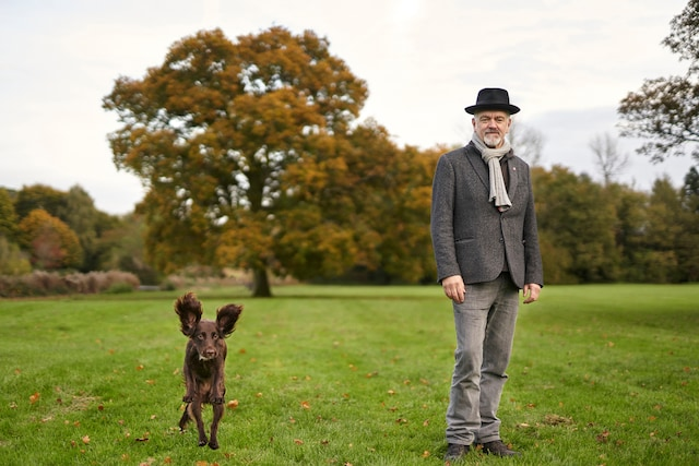 George Brooks and his dog in the countryside