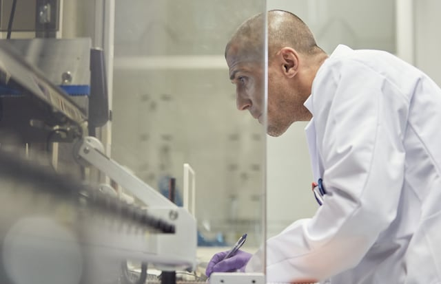 scientist on machine testing story block