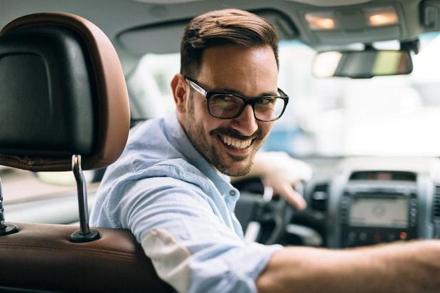 portrait-of-a-businessman-driving-car-FGBZRMU
