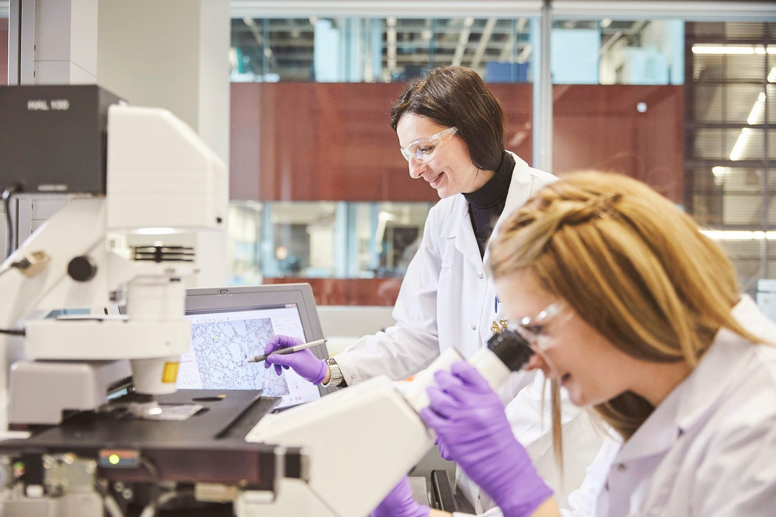 Two female researchers conducting scientific research
