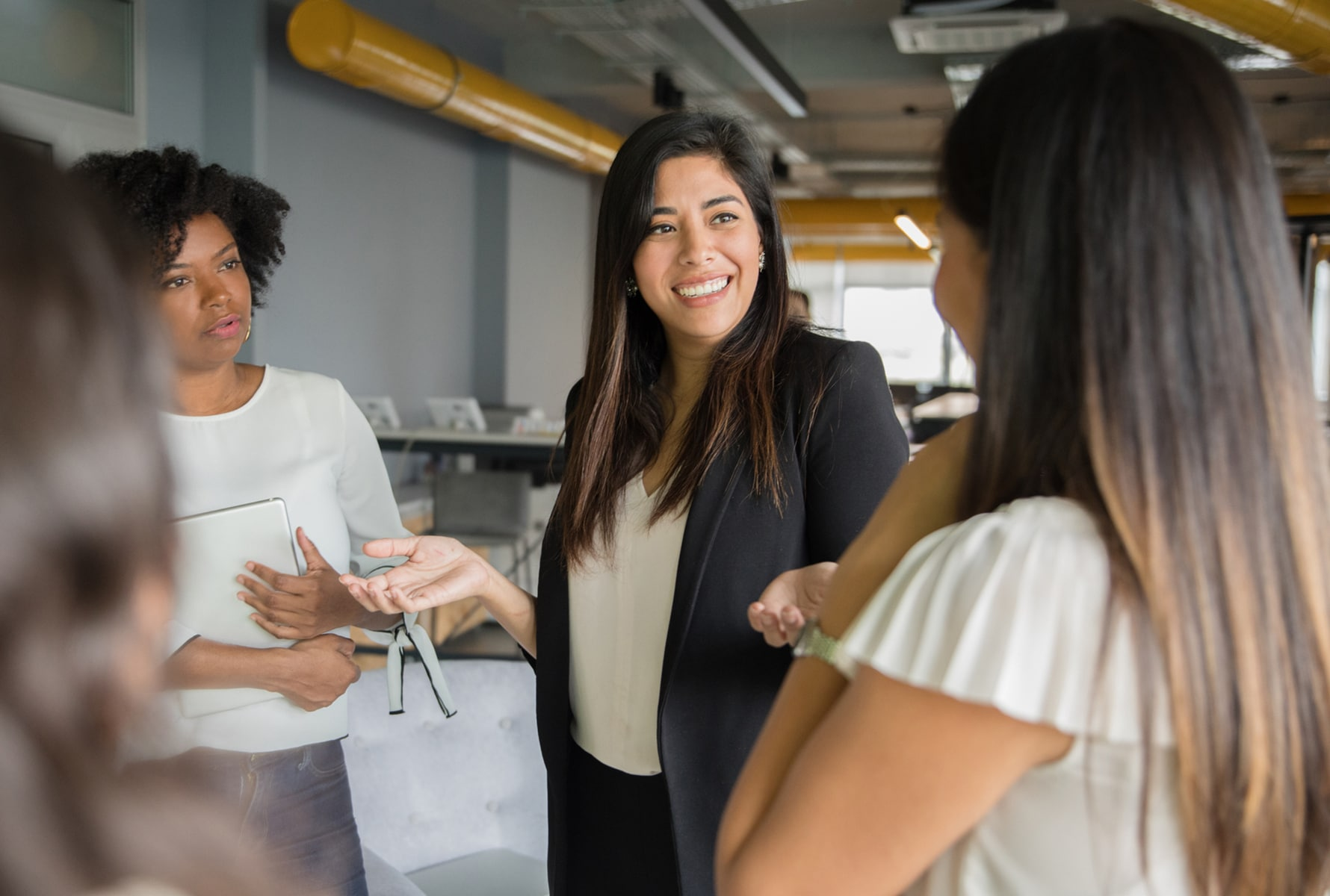 Women discussing skills before a job interview