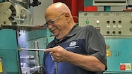 Yvon working in factory thumbnail