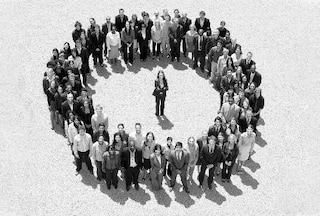 Group of businesspeople looking upwards in a circle