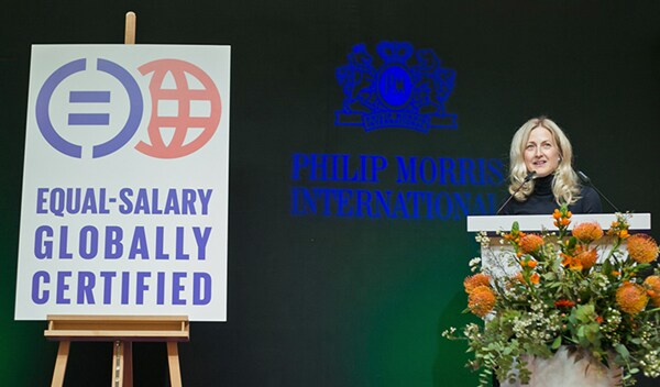 Melissa Whiting announcing PMI being awarded equal salary globally certified
