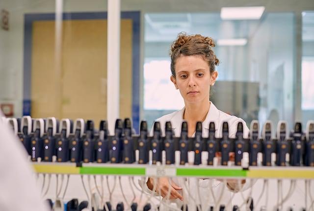 Female scientist in lab highlight crop