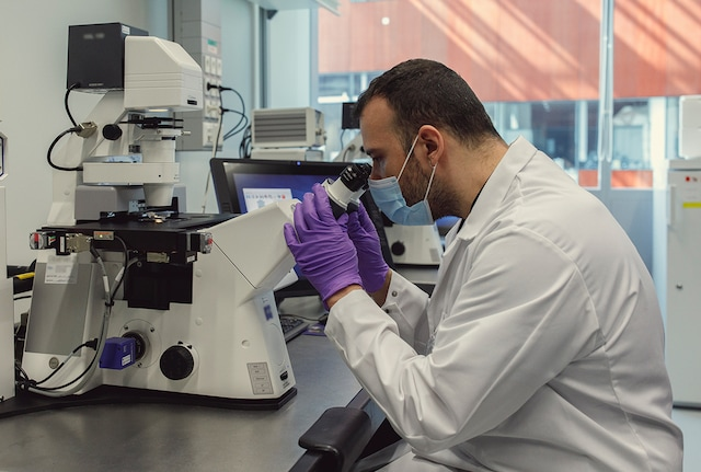 Scientist looking through a microscope