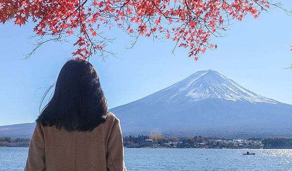 Woman looking at a mountain in Japan