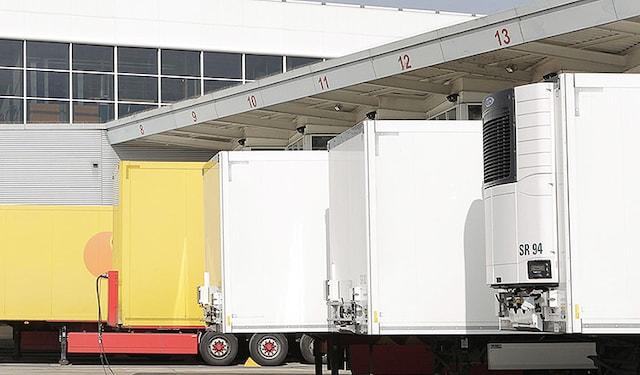 Trucks outside Neuchatel factory OG thumbnail