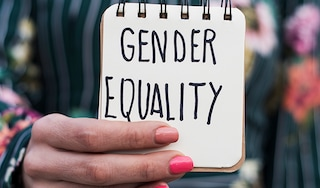 Woman holding a sign for gender equality