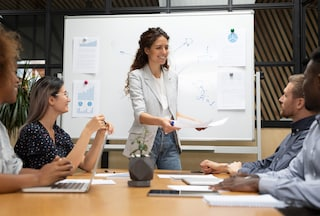 Smiling businesswoman leads team meeting