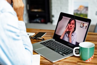 Woman looking unhappy on business video call